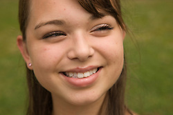 Portrait of a teenage girl smiling in the park,