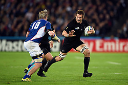 Richie McCaw of New Zealand takes on the Namibia defence - Mandatory byline: Patrick Khachfe/JMP - 07966 386802 - 24/09/2015 - RUGBY UNION - The Stadium, Queen Elizabeth Olympic Park - London, England - New Zealand v Namibia - Rugby World Cup 2015 Pool C.