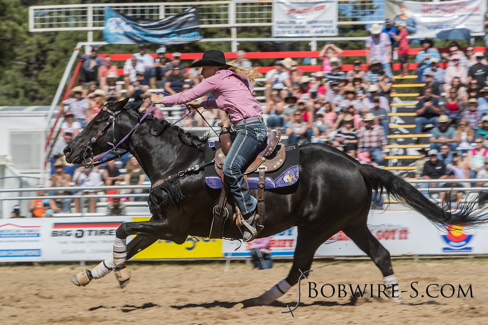 Carla Beckett makes her barrel racing run in the first performance of the Elizabeth Stampede on Saturday, June 2, 2018.