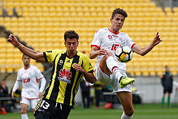Adelaide United's George Blackwood, right, controls the ball in the air as the Phoenix's Marco Rossi attacks from the left in the A-League football match at Westpac Stadium, Wellington, New Zealand, Sunday, October 08, 2017. Credit:SNPA / Dean Pemberton **NO ARCHIVING**