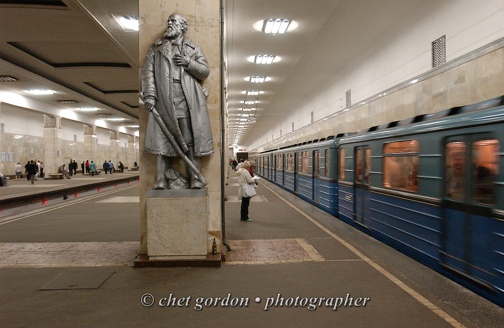 Passengers wait for an arriving train in a Metro station in Moscow, Russian Federation on Wednesday, June 8, 2005.