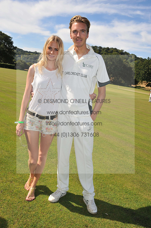 POPPY DELEVIGNE and JAMES COOK at a cricket match to in aid of CARE - Corfu Animal Rescue Establishment held at Hawkley Cricket Club, Hawkley, Hampshire on 8th September 2012.