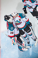 KELOWNA, CANADA - APRIL 8: Rodney Southam #17 congratulates Michael Herringer #30 of the Kelowna Rockets on the game win against the Portland Winterhawks on April 8, 2017 at Prospera Place in Kelowna, British Columbia, Canada.  (Photo by Marissa Baecker/Shoot the Breeze)  *** Local Caption ***
