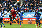 Nottingham Forest defender Tobias Figueiredo (3) beats Wigan Athletic defender Charlie Mulgrew (16) in the air during the EFL Sky Bet Championship match between Wigan Athletic and Nottingham Forest at the DW Stadium, Wigan, England on 20 October 2019.