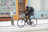 Cycling through the falling snow. Toronto, Canada.