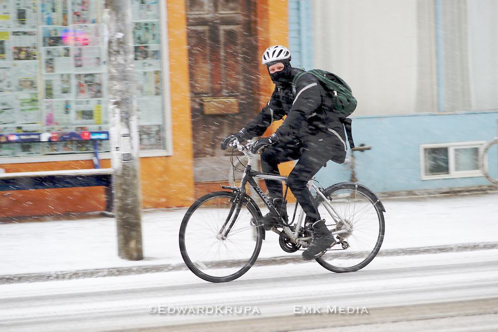 Cycling through the falling snow. Toronto, Canada.