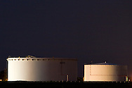 Two giant white oil storage tanks on a tank farm in the far suburbs of Chicago, IL.
