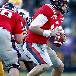 November 17, 2012; Baton Rouge, LA, USA;  Ole Miss Rebels quarterback Bo Wallace (14) against the LSU Tigers during the first half of a game at Tiger Stadium.  Mandatory Credit: Derick E. Hingle-US PRESSWIRE