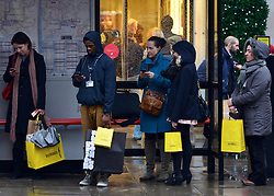 © Licensed to London News Pictures. 20/12/2012. London, UK Shoppers on Oxford Street today 20 December 2012. Shops have started their traditional Christmas Sales as the latest retail sales figures are revealed, shoppers are urged to use smaller shops if they want to keep them alive. Fears that consumers are reining in their spending ahead of Christmas were fuelled after the latest retail figures showed a 0.1% rise in retail sales in November. Photo credit : Stephen Simpson/LNP