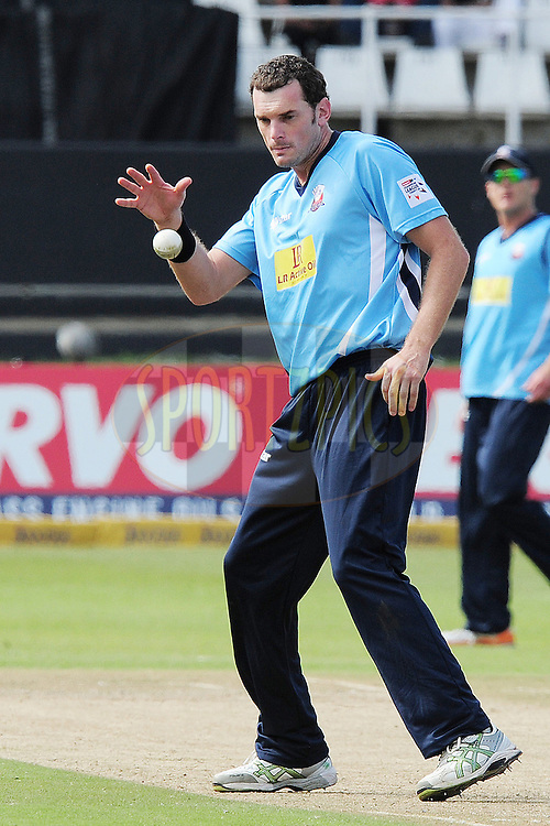 Kyle Mills going for the ball during match 8 of the Karbonn Smart CLT20 South Africa between The Titans and The Auckland Aces held at Kingsmead Park in Durban, South Africa on the 17th October 2012..Photo by Gerhard Duraan/SPORTZPICS/CLT20