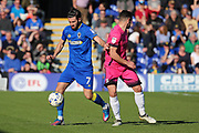 AFC Wimbledon defender George Francomb (7) taking on Southend United midfielder Stephen McLaughlin (11) during the EFL Sky Bet League 1 match between AFC Wimbledon and Southend United at the Cherry Red Records Stadium, Kingston, England on 25 March 2017. Photo by Matthew Redman.
