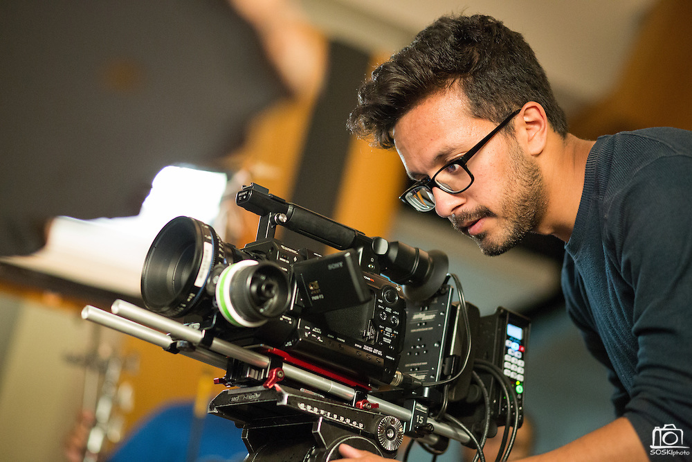 Cinematographer Shaan Aslam, San Jose State University Radio, Television, and Film junior, of Spartan Film Studios controls the camera during a filming of Sammy Spartan Graduates at Dr. Martin Luther King, Jr. Library in San Jose, California, on May 2, 2013. (Stan Olszewski/SOSKIphoto)