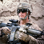 Location:<br /> Patrol Base Fires, Sangin District, Helmand Province, Afghanistan<br /> <br /> Unit:<br /> 3rd Squad, 1st Platoon, Bravo Company, 1st Battalion, 5th Marines<br /> <br /> Name and Rank:<br /> Lance Corporal John Richard &quot;Bo&quot; Bohlinger<br /> <br /> Age: 20<br /> <br /> Hometown: Cheyenne, Wyoming.<br /> <br /> Interview selections:<br /> <br /> Describe Sangin:<br /> <br /> &quot;It's like a firefight in a minefield.&quot;<br /> <br /> How does Sangin compare with your expectations?<br /> <br /> &quot;When we were first coming I was honestly expecting you couldn't move without hitting an IED and there were Taliban everywhere, and everyone was getting shot and blown up . . . that was my expectation . . . and it has not let me down.&quot;<br /> <br /> &quot;I don't think I had respect for the IEDs that I do now after seeing a few friends get hit. Knowing that you can step right next to one or sit with one right between your legs and never know it's there until someone steps on it and dies.&quot;<br /> <br /> What do you think the Taliban are fighting for?<br /> <br /> &quot;I think in their minds they think they're doing the right thing . . . it's just different ideals. I think they're thinking that they're winning the war and they're showing that America can't run the world.&quot;<br /> <br /> What's the hardest part of your job?<br /> <br /> &quot;I'm an RO, radio operator. The hardest part of my job has to be calling up casualties. I hate calling up casualties 'cause it's my friends and my brothers that're fucked up . . . yeah, that's the hardest part.&quot;<br /> <br /> Talk about one of your friends who was killed.<br /> <br /> &quot;My closest friend of the whole thing was Lance Corporal McDaniels . . . We had this joke going that if we took contact , I was gonna get up with him on point and he was gonna sweep right towards the fire and we were both gonna take extremity wounds and go home to our wives. You know, be in the hospital together and shit so we wouldn't be alone . . . that's the last thing I said to him before he fucking got blown in half.&quot;<br /> <br /> How do you deal with so much death and injury?<br /> <br /> &quot;In just over a month we lost over a third of our platoon . . . I don't know, at first . . . it just fucking hu