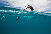 Alexy Berthet prefers to prone paddle, but still shows great poise standing up.