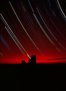 Dawn glow and star trails, Mittens, Monument Valley, Arizona