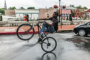 "Annapolis, Maryland - June 05, 2016: Tay Johnson, from Annapolis, rides his bicycle along Dock Street in Historic Annapolis Sunday June 5th, 2016. Dock Street is a section of Annapolis that suffers from nuisance flooding which was exacerbated that day by the morning's perigean spring tide and the afternoon's brief thunderstorms.<br /> <br /> <br /> A perigean spring tide brings nuisance flooding to Annapolis, Md. These phenomena -- colloquially know as a ""King Tides"" -- happen three to four times a year and create the highest tides for coastal areas, except when storms aren't a factor. Annapolis is extremely susceptible to nuisance flooding anyway, but the amount of nuisance flooding has skyrocketed in the last ten years. Scientists point to climate change for this uptick. <br /> <br /> <br /> CREDIT: Matt Roth for The New York Times<br /> Assignment ID: 30191272A"