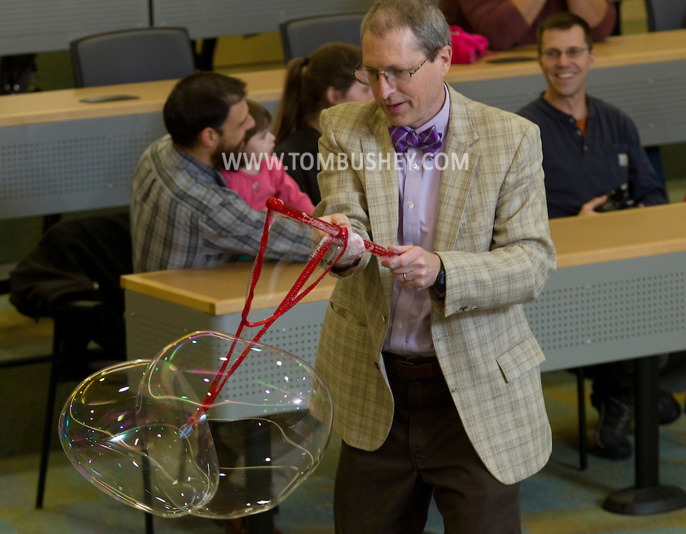Middletown, New York - Professor Timothy MacMahon makes large bubbles during Kids Chemistry Night at SUNY Orange on Oct. 24, 2014. The program was sponsored by the college  Chemistry Club and the American Chemical Society.