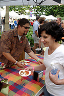 People gather up the samples as fast as Trader Joe's First Mate Jeremy Gulledge sets them out during the 21st annual The Taste in the Lincoln Park Commons area at the Fraze Pavilion, Thursday, September 3, 2009.