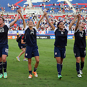 U.S. forward Abby Wambach (20), U.S. defender Stephanie Cox (14), U.S. forward Sydney Leroux (2), U.S. midfielder Lauren Holiday (12) and U.S. forward Christen Press (23) wave to fans after winning an  international friendly soccer match between the United States Women's National soccer team and the Russia National soccer team at FAU Stadium on Saturday, February 8, in Boca Raton, Florida. (AP Photo/Alex Menendez)