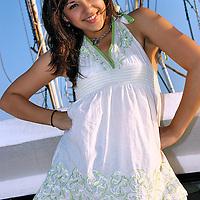 Gabi Salcido, a spokesmodel for TheCrushGirls.com, poses on a shrimp boat in Corpus Christi, Texas.