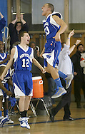 Monticello's Anthony Gray (23) and Ros Djonbalaj (15) celebrate after their team defeated Wallkill in a Section 9 Class A tournament game in Wallkill on Monday, Feb. 28, 2011.