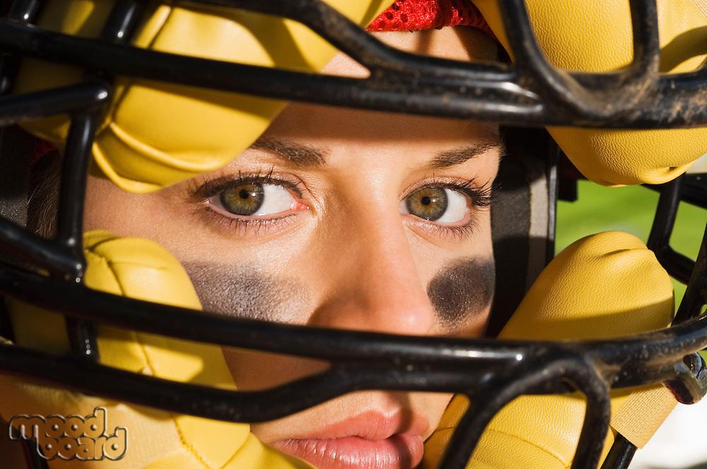 Softball player wearing helmet close-up of face
