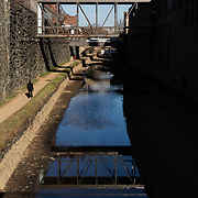 WASHINGTON, DC - MAR23: A man walks along the towpath of the Chesapeake and Ohio (C&O) Canal in Georgetown, March 23, 2017. Georgetown Heritage, the National Park Service, and the DC Office of Planning are planning to upgrade the one mile stretch of the C&O Canal that runs through Georgetown to create a destination experience like the Highline in New York City. (Photo by Evelyn Hockstein/For The Washington Post)