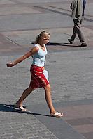 Woman walking on the Rynkek in Krakow Poland