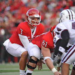 Oct 10, 2009; Piscataway, NJ, USA; Rutgers quarterback Tom Savage (7) sets up under center Ryan Blaszczyk (61) during first half NCAA college football action between Rutgers and Texas Southern at Rutgers Stadium.