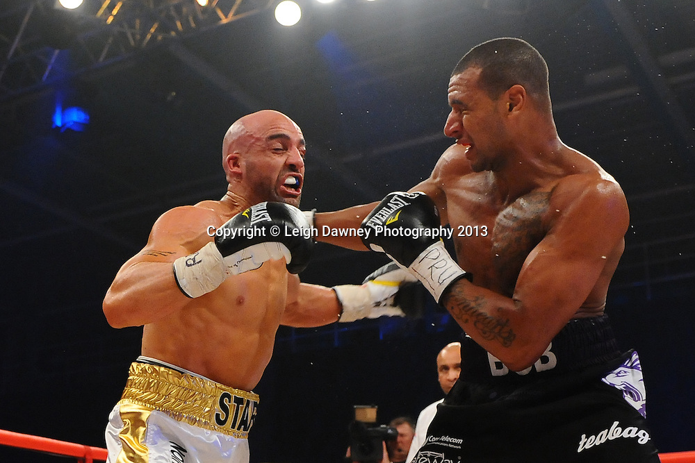 Bob Ajisafe defeats Dean Francis for the Vacant British Light Heavyweight Title on 15th March 2014 at the Rivermead Leisure Centre, Reading, Berkshire. Promoted by Hennessy Sports. © Leigh Dawney Photography 2014.