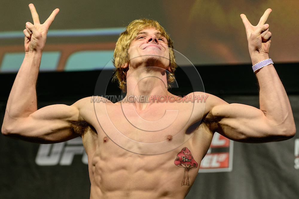LONDON, ENGLAND, FEBRUARY 15, 2013: Matthew Riddle steps on the scales during the official weigh-ins for UFC on Fuel TV 7 inside Wembley Arena in London, England on Friday, February 15, 2013 © Martin McNeil