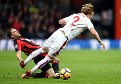 AFC Bournemouth's Dan Gosling (left) tackles Stoke City's Moritz Bauer during the Premier League match at the Vitality Stadium, Bournemouth.