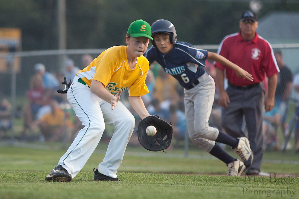 Erial's Jason Reynolds grabs a bouncing ground ball and throws the runner out at second during the Little League State Tournament finals between Paramus and Erial held in Williamstown Tuesday night.