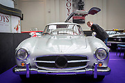 UNITED KINGDOM, London: 24 April 2018 Adam Dornan, aged 12, from Belfast, takes a closer look at a 1988 Ostermeier 'Gullwing'. The car forms part of the Spring Classics: An Important Auction of Fine Historic Automobiles at The Royal Horticultural Halls, Westminster. The auction will see a collection of privately owned cars be auctioned this evening April 24th 2018. Rick Findler  / Story Picture Agency