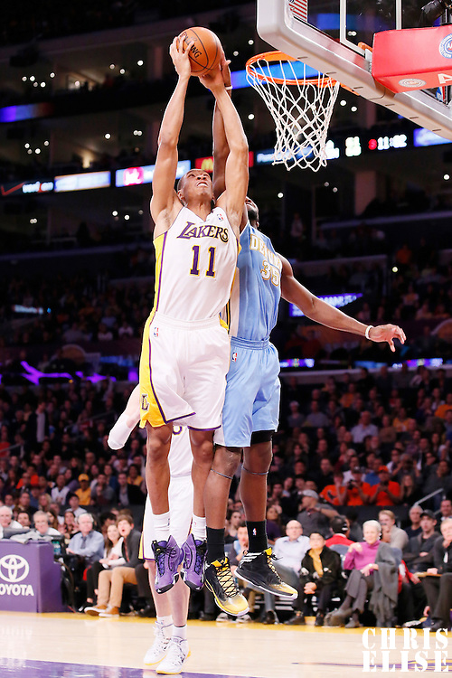 05 January 2014: Denver Nuggets power forward Kenneth Faried (35) blocks Los Angeles Lakers shooting guard Wesley Johnson (11) during the Denver Nuggets 137-115 victory over the Los Angeles Lakers at the Staples Center, Los Angeles, California, USA.