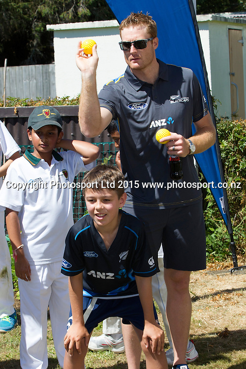 Lukasz  with Martin Guptill practice their bowling skills. Brothers Lukasz (10) and Kazik (8) Swain were winners of the ANZ Field Your Dream competition and had their front yard transformed to play cricket and to meet their Blackcap heroes, Auckland, New Zealand, Sunday, January 18, 2015. Copyright photo: David Rowland/www.photosport.co.nz