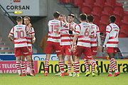 Doncaster celebrate as Liam Mandeville (14) scores a goal 3-0 during the The FA Cup match between Doncaster Rovers and Scunthorpe United at the Keepmoat Stadium, Doncaster, England on 3 December 2017. Photo by Craig Zadoroznyj.