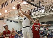 Cedar Rapids Xavier's Matt Nelson (33) puts up a shot under the basket as Ottumwa's Gage Ryder (52) defends during their game at Xavier High School in Cedar Rapids on December 10, 2013.