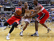 March 29, 2012; Indianapolis, IN, USA; Washington Wizards guard Shelvin Mack (22) tries to maintain control of the ball from Washington Wizards forward Kevin Seraphin (13) as Indiana Pacers shooting guard George Hill (3) guards  at Bankers Life Fieldhouse. Mandatory credit: Michael Hickey-US PRESSWIRE