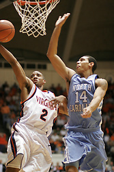 J. R. Reynolds (2) shoots a layup over a UNC defender.  Reynolds had 16 points to help the Hoos to a 72-68 victory over the Tarheels.
