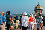 A group of foreigners looking at Taj Mahal from the Agra Fort in Agra, Uttar Pradesh.