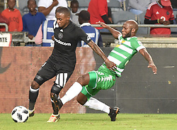 Orlando Pirates player battle for the ball with Jacky Motshegwa  of Bloemfontein Celtic during the; ABSA premiership league at Orlando stadium; Soweto.; <br />
