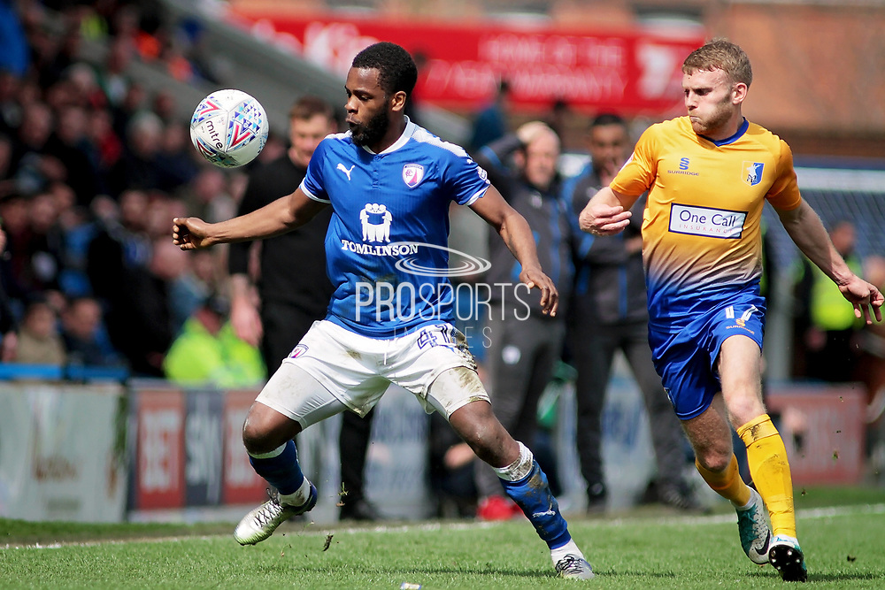 Chesterfield midfielder Zavon Hines (41)  shields the ball from Mansfield Town midfielder Alfie Potter (17) during the EFL Sky Bet League 2 match between Chesterfield and Mansfield Town at the Proact stadium, Chesterfield, England on 14 A pril 2018. Picture by Nigel Cole.