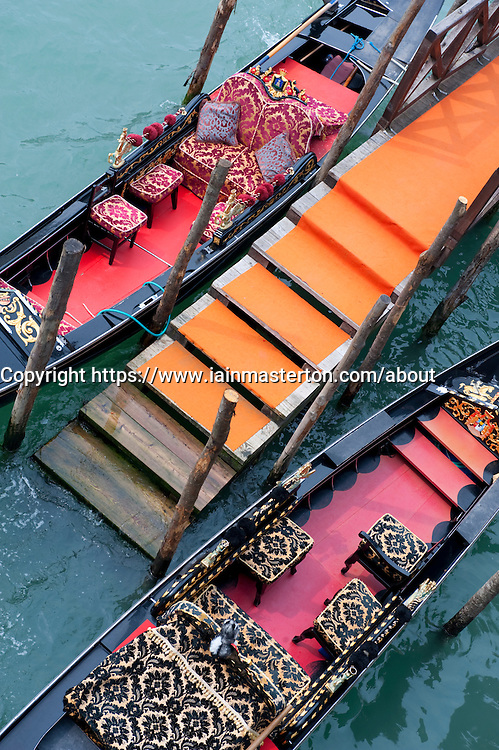 Gondolas moored at dock on Grand Canal in Venice