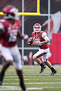 FAYETTEVILLE, AR - SEPTEMBER 28:  Brandon Allen #10 of the Arkansas Razorbacks rolls out looking for a receiver during a game against the Texas A&M Aggies at Razorback Stadium on September 28, 2013 in Fayetteville, Arkansas.  The Aggies defeated the Razorbacks 45-33.  (Photo by Wesley Hitt/Getty Images) *** Local Caption *** Brandon Allen