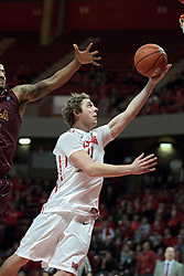 11 January 2014:  Matt Stacho sets a break away lay up on the glass, the ball misses, but he gets an ovation from the crowd during an NCAA  mens basketball game between the Ramblers of Loyola University and the Illinois State Redbirds  in Redbird Arena, Normal IL.  Redbirds win 59-50