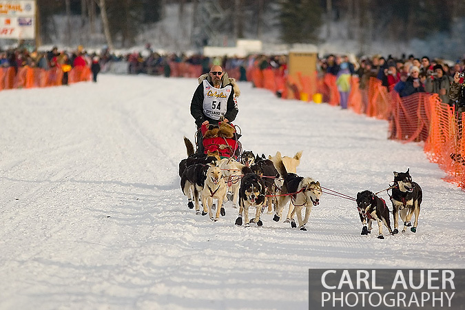 05 March 2006: Willow, Alaska - Paul Ellering, former professional wrestler, has some trouble with his lead dog during the restart of the 2006 Iditarod on Willow Lake in Willow, Alaska