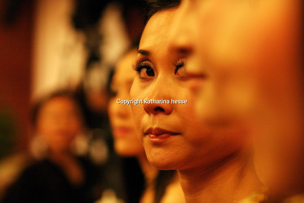 """BEIJING, 12 DECEMBER 2004: a double-lidded contestant of the """"first worldwide artificial beauty pageant """" which will be held in Beijing next week,  looks at her competitors during a press conference in Beijing, December 12, 2003, in China.Organizers dreamed up the pageant after Yang Yuan, , a young woman who paid USD13,000 on cosmetic surgery attemped to sue them for banning her from the finals of a traditional beauty contest last May...Beauty business in China , from cosmetic surgeries to hair brush sales, has amounted to more than USD 7 billion in 2003..."""