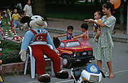 Lenin park. Kids looking at a life-size copy of Mickey Mouse.