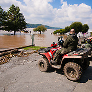 Maryland Natural Resource Police block the entrance to Marina Park in Port Deposit as the Susquehanna river floods the parking lot and playground Saturday, Sept. 10, 2011 in Port Deposit, Md as flooding from the Susquehanna River continues. (AP Photo/Saquan Stimpson)